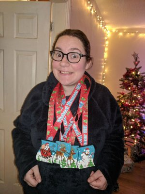 Me looking cheesy with my December 5k medals